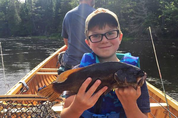 Kids bass fishing in Maine