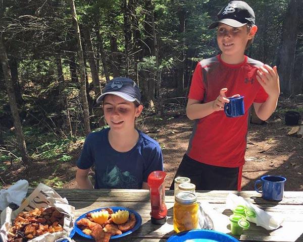 Kids fishing in Grand Lake Stream Maine at Shore Lunch
